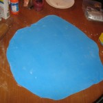 rolling the fondant huge lol i kinda did it a litt